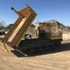 Rubber tracked all terrain carrier/dumper with rear tip dropside body