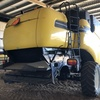 Under Auction - CX 860 New Holland Harvestor with 40' Honeybee Draper Front & Trailer - 2% Buyers Premium on all lots