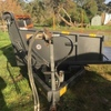 Hydraulic square and round bale feeder