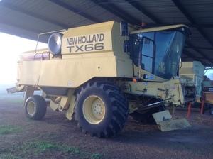 NH TX66 combine harvester s 30ft finger wheel front, 10ft canola pickup and canola screans