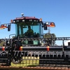 MacDon 155 Windrower with 30ft D60 front, comb trailer and good work to go with it.