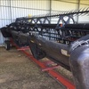 MacDon D60-D  25' in good condition with deck shift and vertical knives, and trailer.