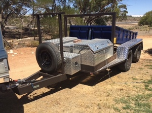Tandem Axle Tipping Trailer with Toolboxes and Carry Frames