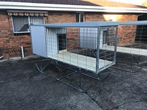 Raised dog kennel