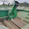JOHN DEERE 9750 STS WITH 936D 36 FOOT DRAPER FRONT ON TRAILER FOR SALE