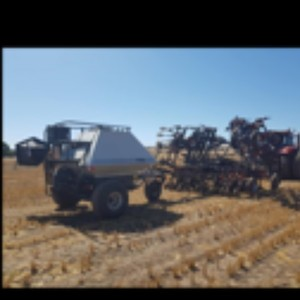 28ft Flexicoil Air Seeder and 1110 Tow behind Cart