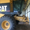Cat Lexion 480 R including MacDon 962 front and trailer.