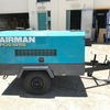 1x Airman 185 cfm diesel screw air compressor on 2 wheel trailer chassis