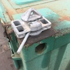 Twist locks for shipping containers