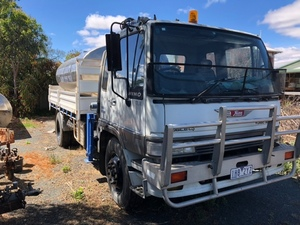 1991 Hino Prime mover with Tray , crane and Tanker - NO GST