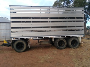2016 20' 3x1 Stock Crate on a Marlin Tri Axle Dog Trailer