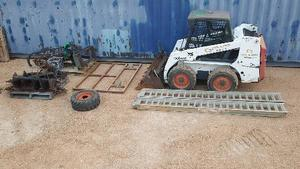 CLARK BOBCAT/SKIDSTEER ,owners/operators manual ,has all attachments,augers,smudgebar,trencher,spare wheels,alloy ramps etc