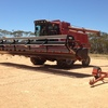 Case IH combine harvester 1680, with auto steer 1010 30ft front on a leith trailer
