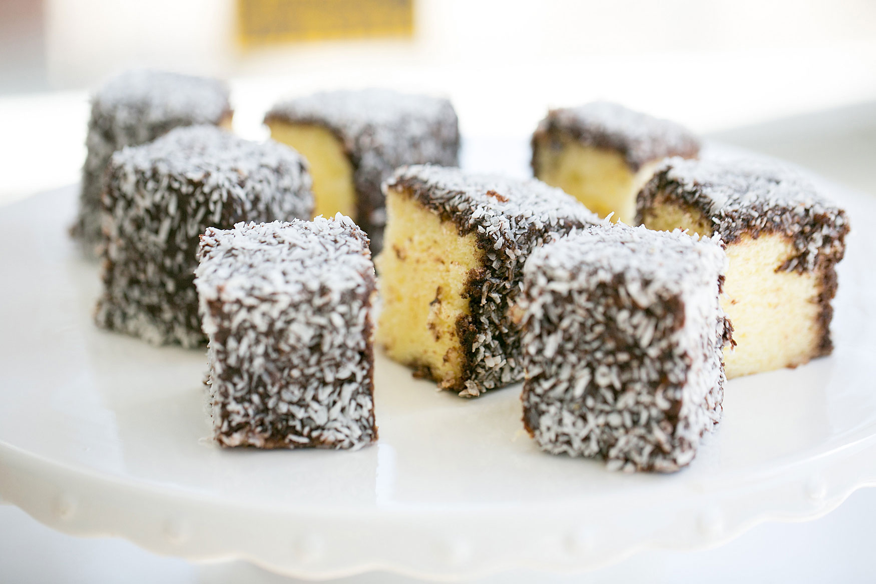 Australian lamington cakes (moist white sponge cake dipped in chocolate and coconut)