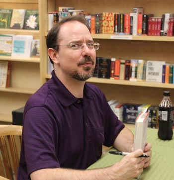 John Scalzi signs a copy of Lock In for Marion.
