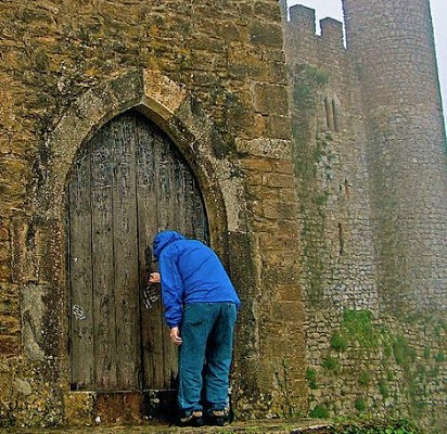 Knocking At Castle Door In Medieval Obidos-portugal by Ruth Hager. purchase print: https://fineartamerica.com/featured/knocking-at-castle-door-in-medieval-obidos-portugal-ruth-hager.html