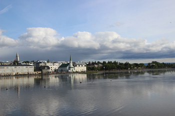 Reflections off Lake Tjornin, also called The Pond, in downtown Reykjavik.