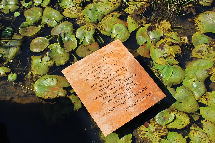 A quote by mythologist and writer Jospeh Campbell in the garden's lily pond.
