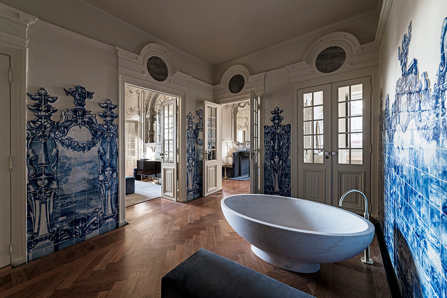 An oversized soaking tub surrounded by 18th-century tiles in the Queen's Suite at Verride Palacio Santa Catarina.
