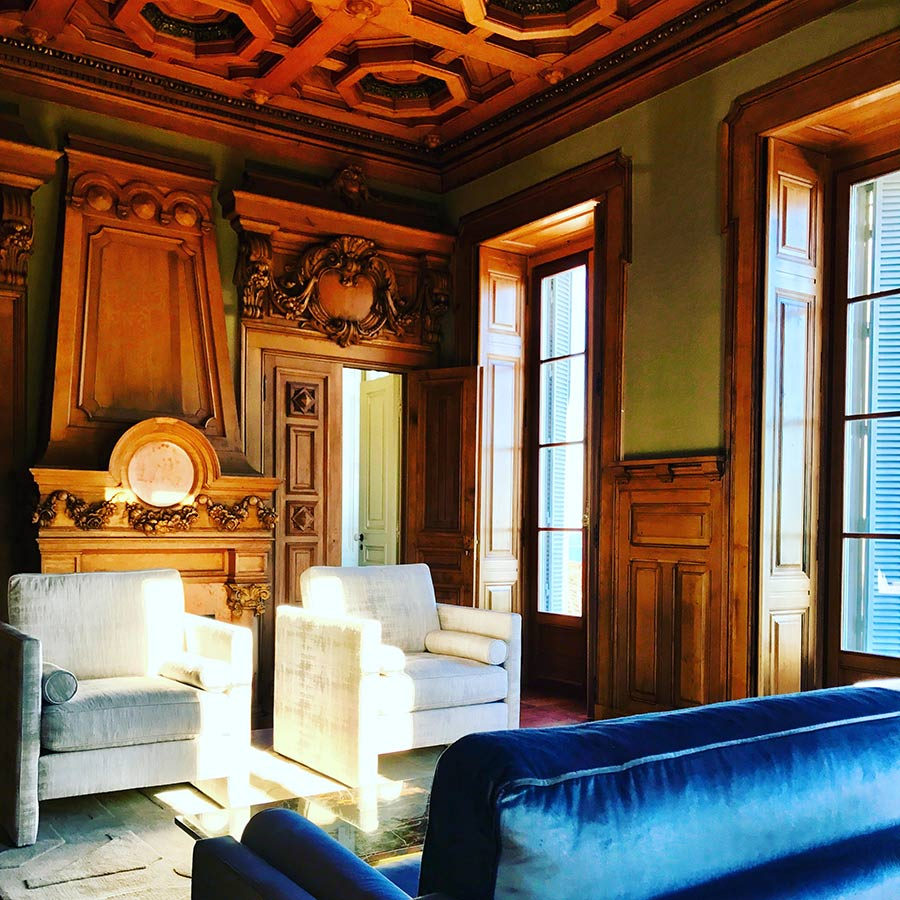 Exquisite original wood paneling in King's Suite at Verride Palacio Santa Catarina.