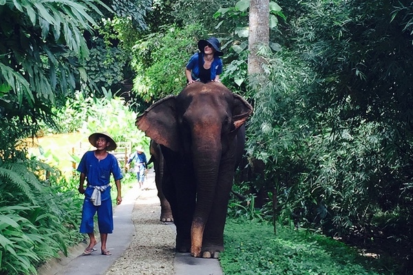 Kate Donnelly riding an elephant at Four Seasons Tented Camp.
