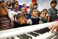 At This Refugee Camp In Berlin, Relief Hits High and Low Notes