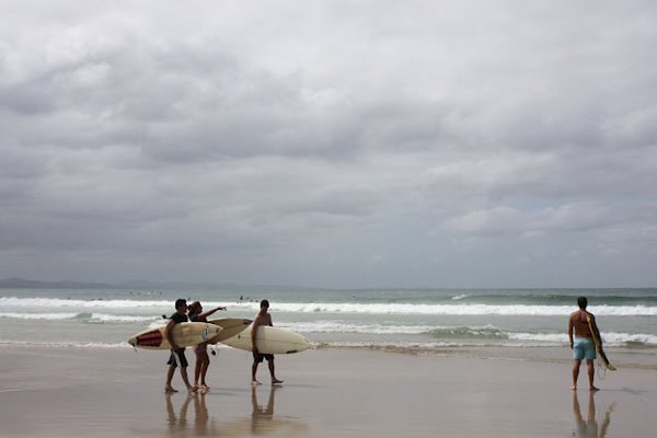 <em>Surfers at Byron Bay.</em>