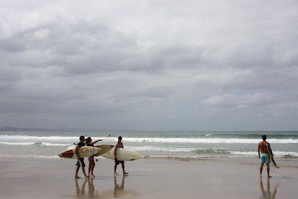 <em>Surfers at Byron Bay.</em>