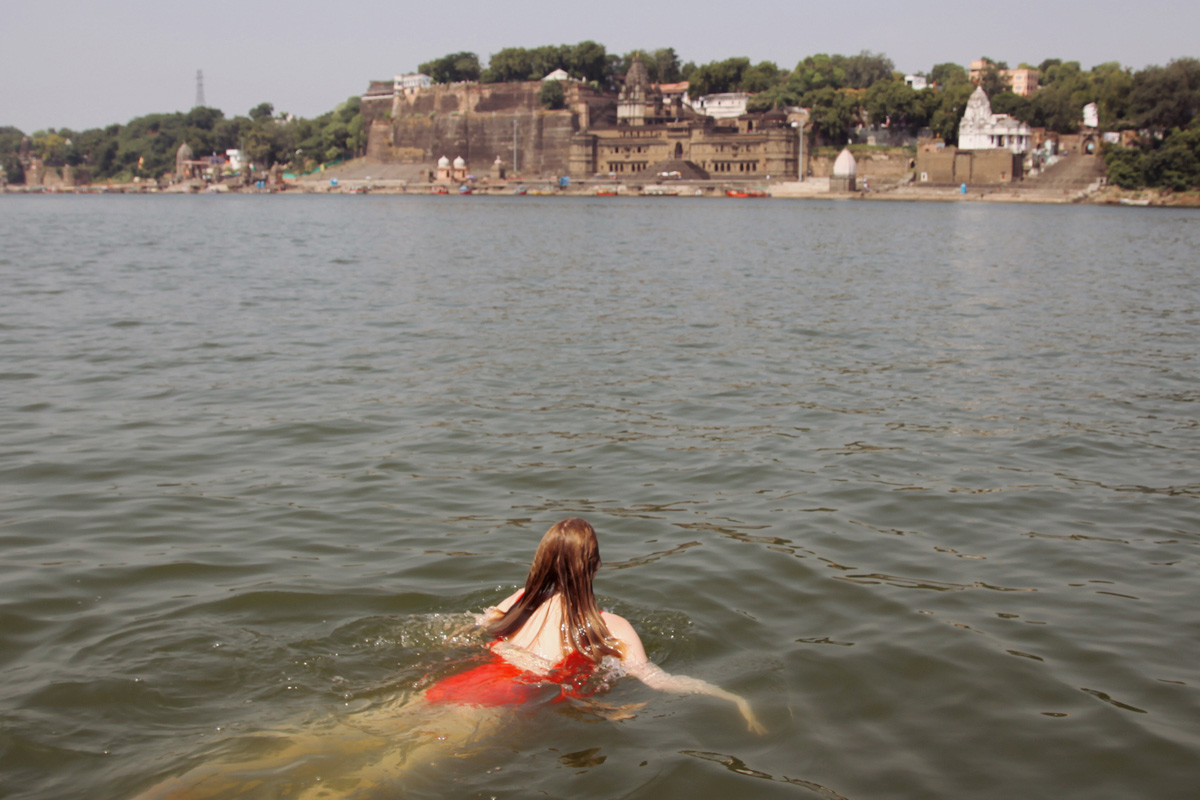 A dip in the holy waters of the Narmada River in India