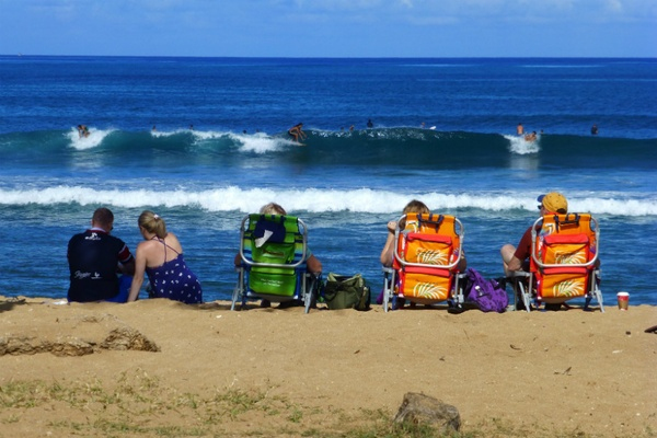 Group watches surfers, Hawaii
