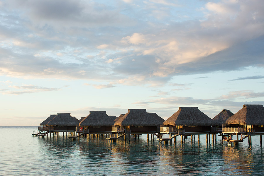 Overwater huts in Tahiti, French Polynesia - Emily Nathan