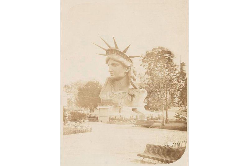 "Head of the Statue of Liberty on display in a Paris park, 1883. Photo: Albert Fernique via <a title=""New York Public Library"" href=""http://www.flickr.com/photos/nypl/3110143502/""target=_blank"">New York Public Library</a> / Flickr"