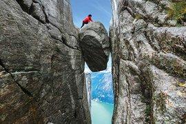 Atop the Kjeragbolten boulder in Norway