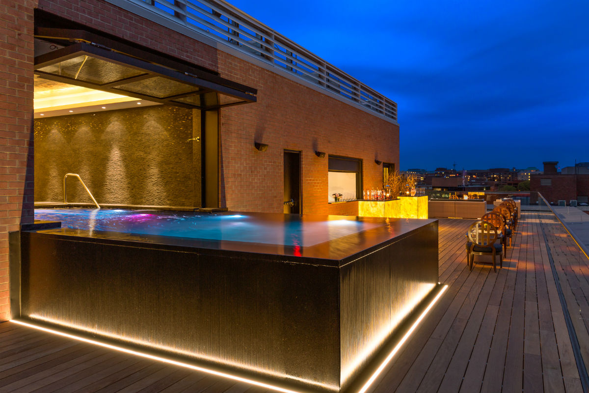 The rooftop pool at the Capella Hotel