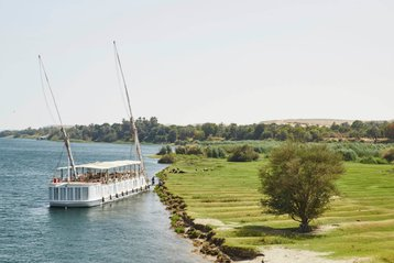 Cruise boat sails down the Nile River in Egypt