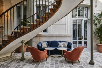 A 300-year old staircase in the lobby of the Hoxton Paris