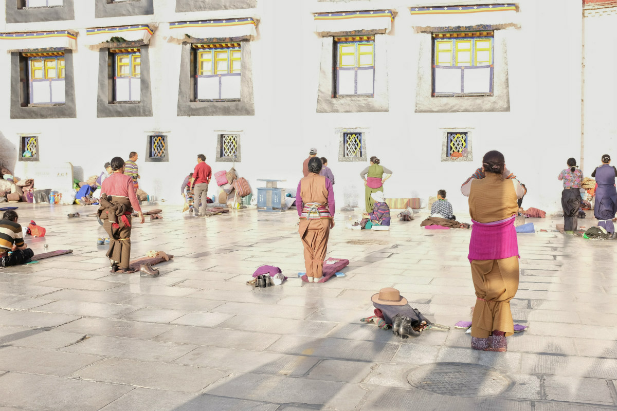 Praying outside Jokhang Temple, Lhasa, Tibet