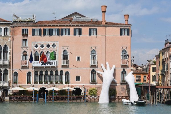 """Support,"" by Lorenzo Quinn at the Venice Biennale."