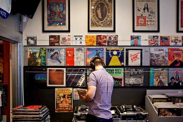 Sampling a vinyl at Licorice Pie, Melbourne.
