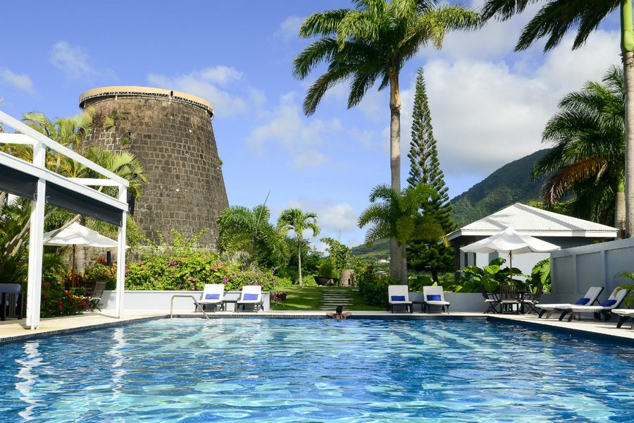 The pool and 300-year-old sugar mill at the Montpelier Plantation & Beach in Nevis