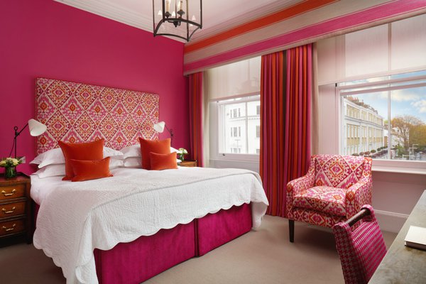 Bright colors pop inside a guest room at The Pelham London