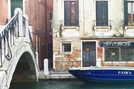 Boats in the canals in Venice, Italy.