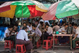 Businessmen eating in Yangon, Myanmar.