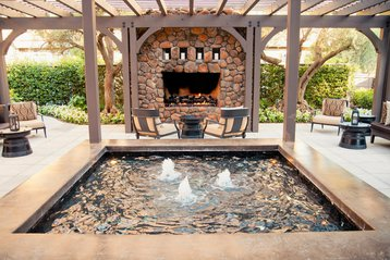 The poolside fireplace and lounge area at Hotel Yountville