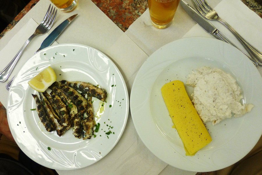 Baccalà mantecato and grilled sardines at Rosticceria Gislon. Photo: Paula de la Cruz