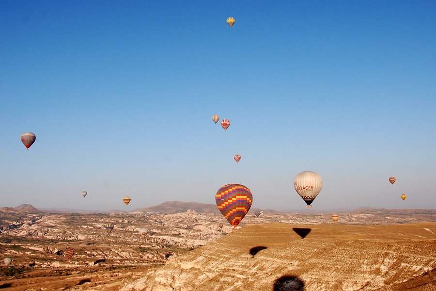 As the balloons fly over Cappadocia.