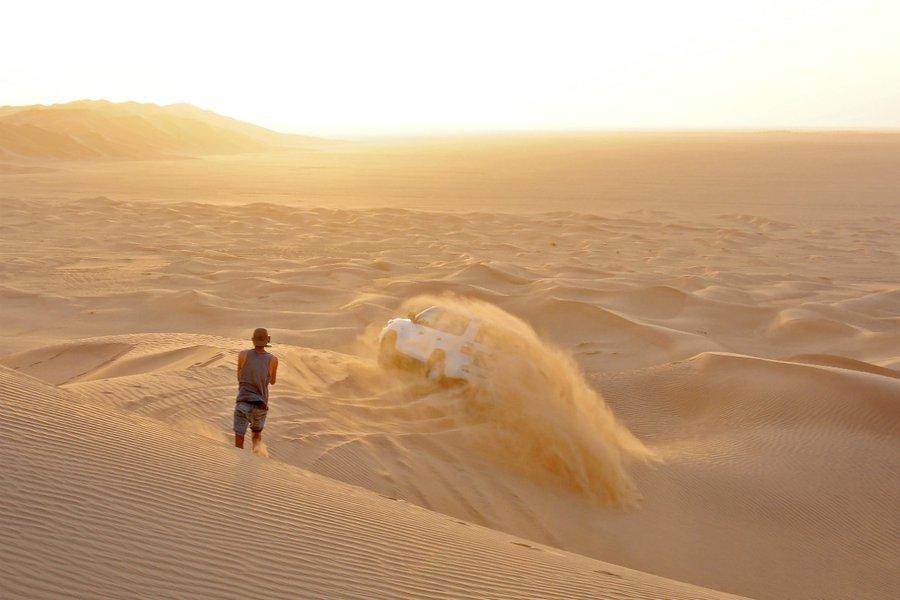 Filming dune bashing in the desert.