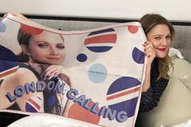 Drew Barrymore with Flower Home London poster.