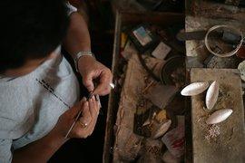 An artisan at work in the Kaligarh workshop.