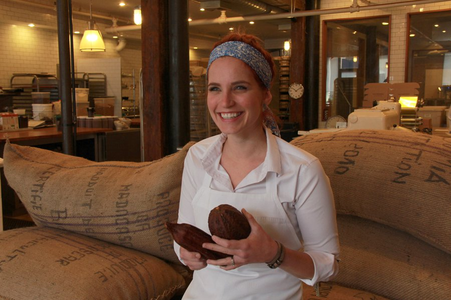 Sales Director Erin with Football-Shaped Cacao Pods